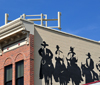 Golden, Jefferson County, Colorado, USA: cowboys on the side of building - mural on Ford Street - photo by M.Torres