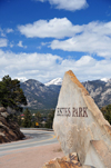 Estes Park, Larimer County, Colorado, USA: town sign on US 36 with the Rocky Mountains peaks as backdrop - schist blade - built to commemorate the 75th Anniversary of the local Rotary Club - photo by M.Torres