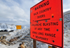 Loveland pass, Colorado, USA: long range cannons are used for avalanche blasting - warning sign - photo by M.Torres