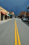 Santa F�, New Mexico, USA: San Francisco street, looking east - dark sky 2 minutes before the rain - double yellow line - photo by M.Torres