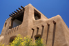 Santa F�, New Mexico, USA: New Mexico Museum of Art, former Museum of Fine Arts - 1 PM shadows - rounded adobe construction with dark wood details - Pueblo architecture - photo by A.Ferrari