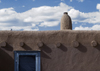 Pueblo de Taos, New Mexico, USA: architectural details - blue door and chimney - photo by C.Lovell