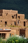 Pueblo de Taos, New Mexico, USA: adobe houses - each year after the end of the rains the walls are covered with a new coat of adobe plaster - North Pueblo - photo by M.Torres