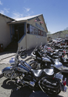 Madrid, Santa Fe County, New Mexico,USA: Harley Davidson motorcycles parked at the Mine Shaft Tavern on route 14, south of Santa Fé - photo by C.Lovell