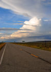 Costilla County, Colorado, USA: dramatic sky with distant rain over route CO-169, south of San Luis - stratus, cumulus and cirrostratus clouds - emptiness of the great spaces - photo by M.Torres