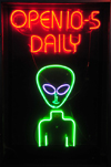 Roswell, Chaves County, New Mexico, US: neon alien on Main Street - entrance to the UFO 'Museum' - photo by M.Torres