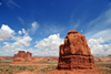 Arches National Park, Utah, USA: Courthouse Towers - butte with the Organ fin in the background - blue sky with cumulus clouds - photo by M.Torres