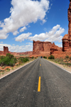 Arches National Park, Utah, USA: Courthouse Towers - Tower of Babel and Sheep Rock seen from the road - asphalt and yellow line on Arches Entrance Road - photo by M.Torres