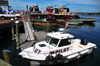 Portsmouth, New Hampshire, USA: pilots' boat and tug boats - harbour scene - Ceres St - Tugboat Alley - New England - photo by M.Torres