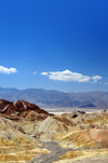 Death Valley National Park, California, USA: Zabriskie Point - view towards Gower Gulch - the flat salt plains on the valley floor and the Panamint Range are visible in the distance - photo by M.Torres