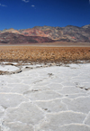 Death Valley National Park, California, USA: Badwater Basin dry lake - salt flats - pattern defined by salt ridges - Amargosa range - photo by M.Torres