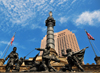 Cleveland, Ohio, USA: Public Square - Soldiers' and Sailors' Monument - honors servicemen from Cuyahoga County in the Civil War Yankee forces - Advance Guard Grouping - sculptures and design by architect Levi T. Scofield - in the background 200 Public Square tower - photo by M.Torres