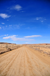 Chaco Canyon National Historical Park, New Mexico, USA: red dirt road and blue sky - photo by M.Torres