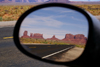 Monument Valley / Tsé Bii' Ndzisgaii, Utah, USA: looking back at Monument Pass - car mirror - Navajo Nation Reservation - photo by A.Ferrari