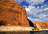 Lake Powell, Utah, USA: a house boat enters Reflection Canyon - photo by C.Lovell