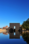 Oklahoma City, OK, USA: Oklahoma City National Memorial - reflecting pool and one of the bronze gates called 'The Gates of Time' - photo by M.Torres
