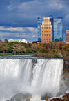 Niagara Falls, New York, USA: cascading waters of Bridal Veil Falls, Luna Island and hotels in the background - aka Iris Falls - photo by M.Torres