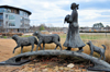 Little Rock, Arkansas, USA: 'sculpture Homeward Bound' - Navajo girl crosses a bridge with a gift of animals - reflective of the hope and self-reliance - Heifer International headquarters - artist Allan Houser - photo by M.Torres