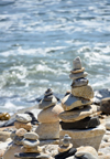 Narragansett Pier, Washington County, Rhode Island, USA: goup of cairns along Ocean road - balancing rocks with the Atlantic ocean as background - photo by M.Torres