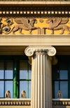 Wilmington, DE, USA: Wilmington Public Library, one of the nation's oldest public libraries - architect Henry Hornbostel, Classical Revival style -  capital of an Ionic order column and frieze with winged lions and blue roses - photo by M.Torres