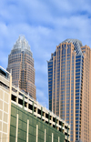 Charlotte, North Carolina, USA: Hearst Tower - North Tryon Street, to the left Bank of America tower and parking deck below - photo by M.Torres