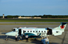 Warwick, Kent County, Rhode Island, USA:  T. F. Green Airport / Providence - Air Canada Express / Air Georgian Beechcraft 1900D C-GORZ (cn UE-134) twin-engine turboprop aircraft - pilot and co-pilot wait - photo by M.Torres