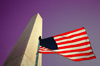 Washington D.C., USA: Washington monument - flag and purple sky - patriotic image - photo by G.Friedman