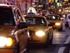 Manhattan (New York City): yellow cabs at Times Square - nocturnal - photo by M.Bergsma
