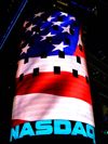 Manhattan (New York City): Times Square - NASDAQ electronic stock market - NASDAQ MarketSite LED video display - corner of Broadway and 43rd Street - US flag - photo by M.Bergsma