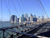 New York City: Brooklyn Bridge - cables and the city - photo by M.Bergsma