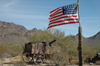 USA - Tombstone, Arizona - O.K. Corral film set - Old Tucson - US Army wagon with gatling gun - American flag - Photo by K.Osborn