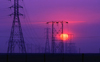 USA - power lines at sunset - pylons - electric power transmission - transmission towers or masts - photo by J.Fekete