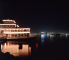 San Diego (California): Night view of San Diego Bay with a floating restaurant - photo by J.Fekete