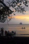 Vanuatu - People boardingzodiac at sunset with ship, Ambrym Island - photo by B.Cain