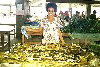 Vanuatu - Efaté island - Port Vila: lady selling lap-lap wrapped in banana leaves
