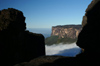46 Venezuela - Bolivar - Canaima NP - Kukenan and clouds, seen between Roraima blacks rock formations - photo by A. Ferrari