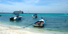 Los Roques, Venezuela: Isla Madrizqui - beach, boats and cruise liner - photo by R.Ziff