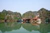 Halong Bay - Vietnam: floating village with limestone karsts reflected on the South China Sea - photo by Tran Thai