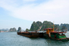 Halong Bay - Vietnam: a barge on the move - photo by Tran Thai
