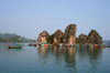 Halong Bay - Vietnam: fishing boat passing a floating village - photo by Tran Thai