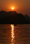 Halong Bay - Vietnam: sunset and fishing boat - photo by Tran Thai