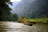 Ba Be National Park - vietnam: river scene - man on a long dug-out canoe - photo by Tran Thai