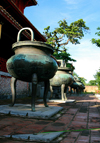 Hue - Vietnam: Nine dynastic urns in front of the The Mieu, the Temple of Generations - Hue citadel - photo by Tran Thai