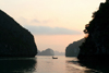 Halong Bay - Vietnam: sunset - small boat in a canal - photo by Tran Thai