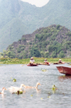 Hue: boats on the Huong River - the Perfumed river - photo by N.Cabana