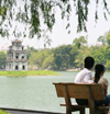 Hanoi - Vietnam - Hoan Kiem Lake - couple on a bench - photo by Tran Thai