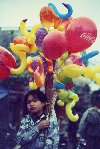 Child selling ballons (photo by Joe Filshie)