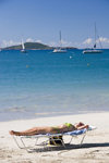 Tortola: Cane Garden Bay, BVI: Caribbean relaxation - woman sunbathing - photo by D.Smith