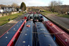 Llangollen, Denbighshire / Sir Ddinbych, Wales, UK: canal longboats lined up waiting for tour duty - photo by I.Middleton