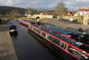 Llangollen, Denbighshire / Sir Ddinbych, Wales, UK: canal longboats lined up - Golden Meadow - photo by I.Middleton